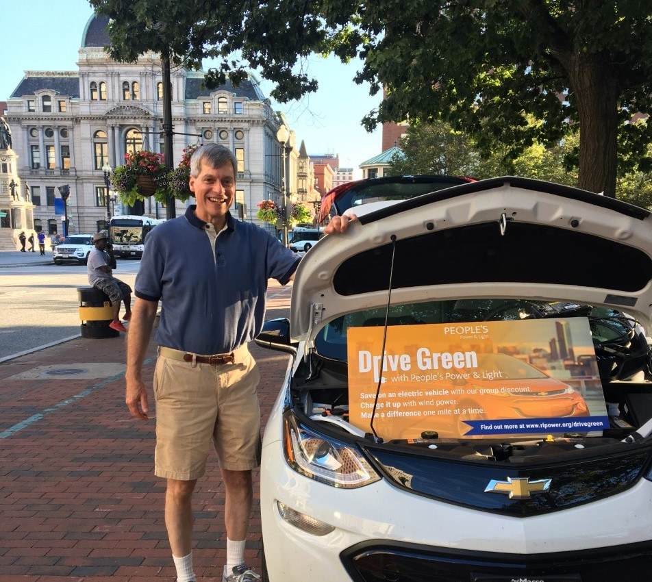 Man with his Chevrolet Bolt at our event